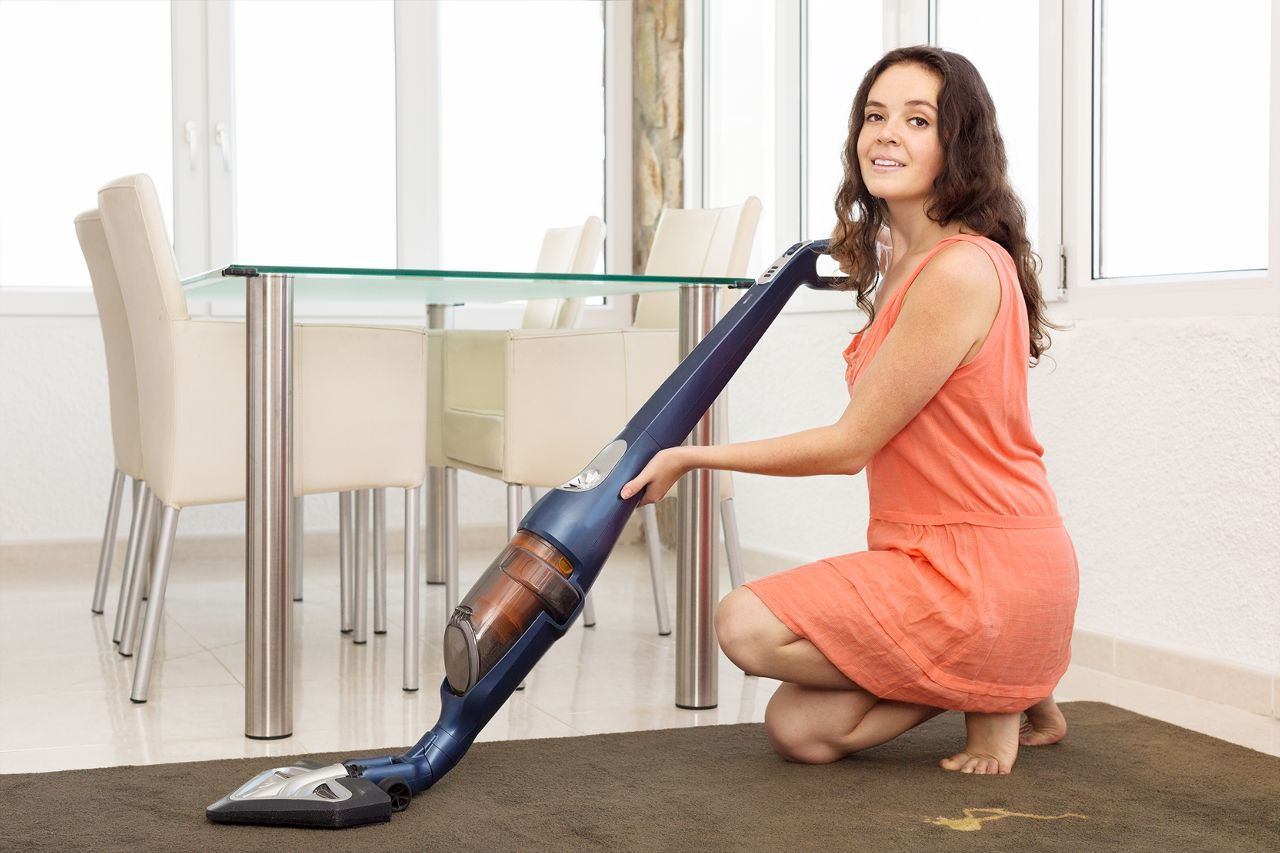 1280-502095870-woman-cleaning-with-vacuum-cleaner